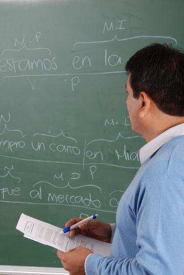 Professor in front of chalkboard.