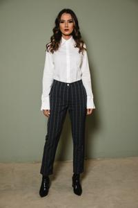 woman wearing pants and a blouse