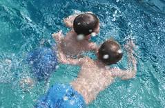 children wearing swimsuits