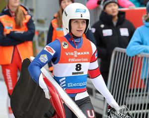 woman wearing a luge uniform and helmet