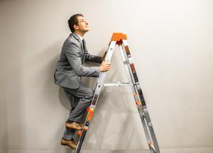 man climbing stepladder