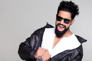 man with black hair and beard