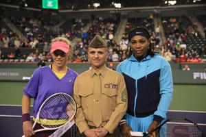 man in military uniform standing with tennis players