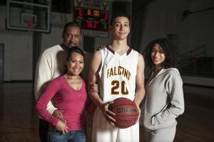 tall basketball player with his family