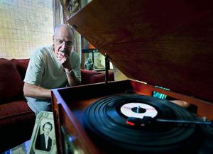 man listening to an old record