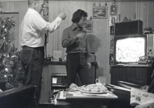 two men watching TV