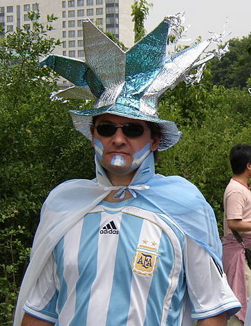 A man dressed like an Argentine flag