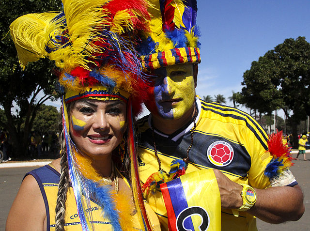 A man and a woman dressed in Colombia's colors